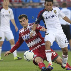 Real Salt Lake Paulo Junior (23) and FC Dallas Bobby Warshaw (16) battle for the ball during the first half of an MLS soccer game on Wednesday, April 25, 2012, in Frisco, Texas.