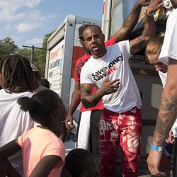 Rapper Vic Mensa hands out shoes.   Rick Majewski/For the Sun-Times