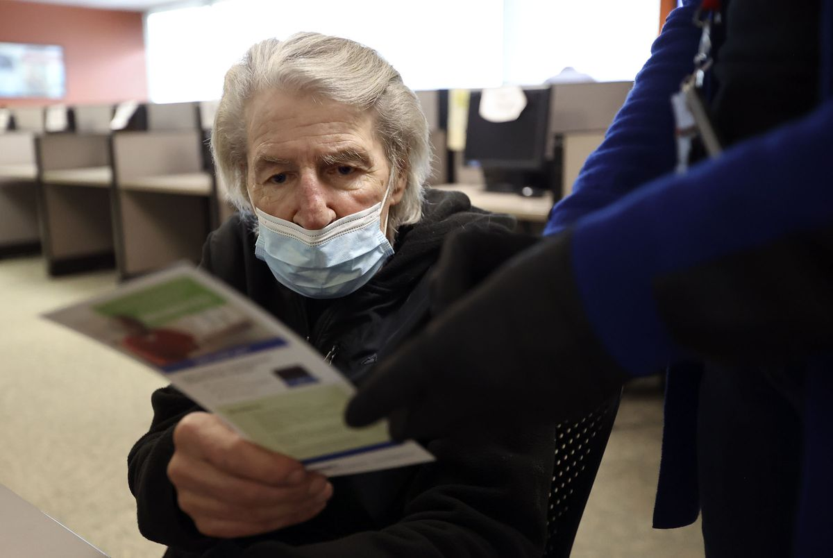 Randi Boyakin looks at a flyer with instructions for how to file for unemployment over the phone at the Department of Workforce Services office in Salt Lake City on Friday, Jan. 22, 2021. The state unemployment rate dropped to 3.6%.