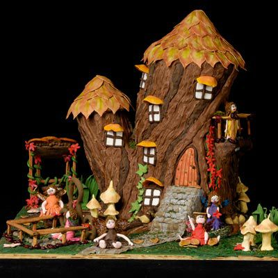 Gingerbread tree house with garden outside.
