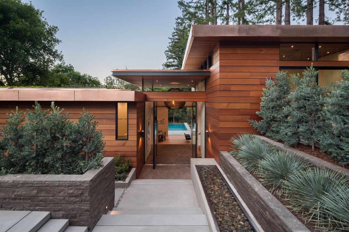 Wood facade (that's gorgeous!) of massive Ross home. Very modern. Angular. Chic.