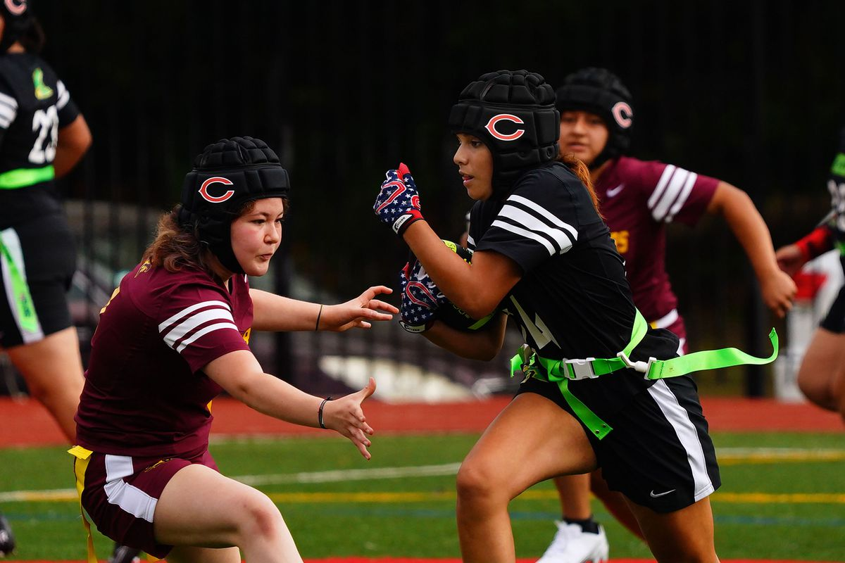 Kelly's Cristina Solano (14) avoids being stopped by Solorio's Diana Lopez (4) on her way to score a touchdown at Kenwood.