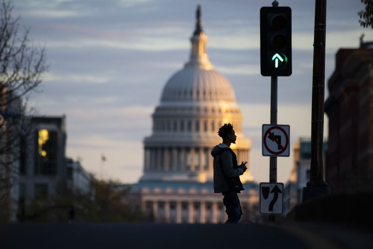 A man walks in front of the U.S. Capitol building during the coronavirus outbreak in April 2020.