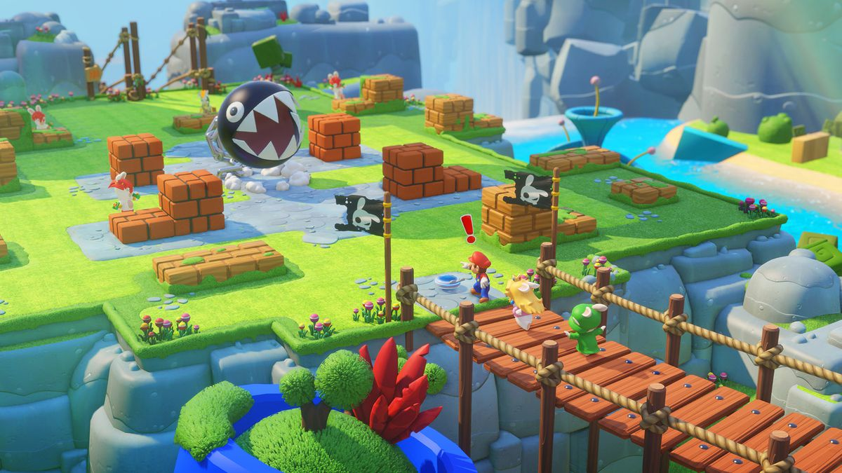 This screenshot from Mario + Rabbids Kingdom Battle shows Mario standing in front of two rabbids who are crossing a bridge. One of the rabbids is dressed as Princess Peach, and one is dressed as Luigi. Mario has an exclamation point above his head and is