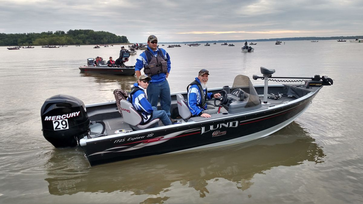 Sophomore Matt Maggiore (left), his senior brother Ken and coach Mike Mulligan had a better weekend after the IHSA's state championship for bass fishing.<br>Credit: Dale Bowman
