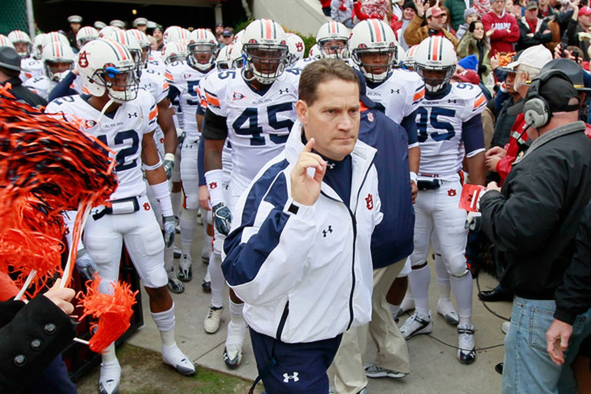 TUSCALOOSA AL - NOVEMBER 26:  Head coach Gene Chizik of the Auburn Tigers leads his team onto the field to face the Alabama Crimson Tide at Bryant-Denny Stadium on November 26 2010 in Tuscaloosa Alabama.  (Photo by Kevin C. Cox/Getty Images)