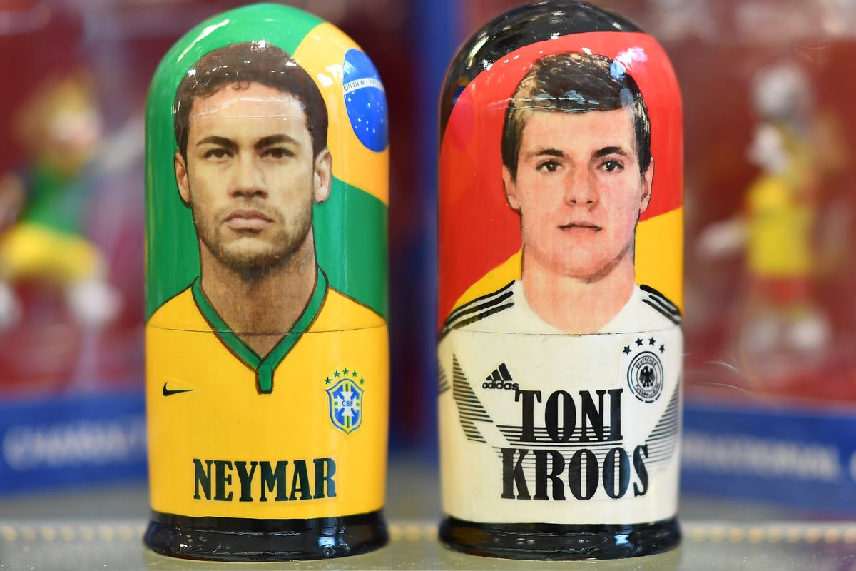 MOSCOW, RUSSIA - JUNE 07: Traditional wooden dolls in the form of Neymar of Brazil and Toni Kroos of Germany are seen in a shop prior to the start of the FIFA 2018 World Cup on June 7, 2018 in Moscow, Russia.