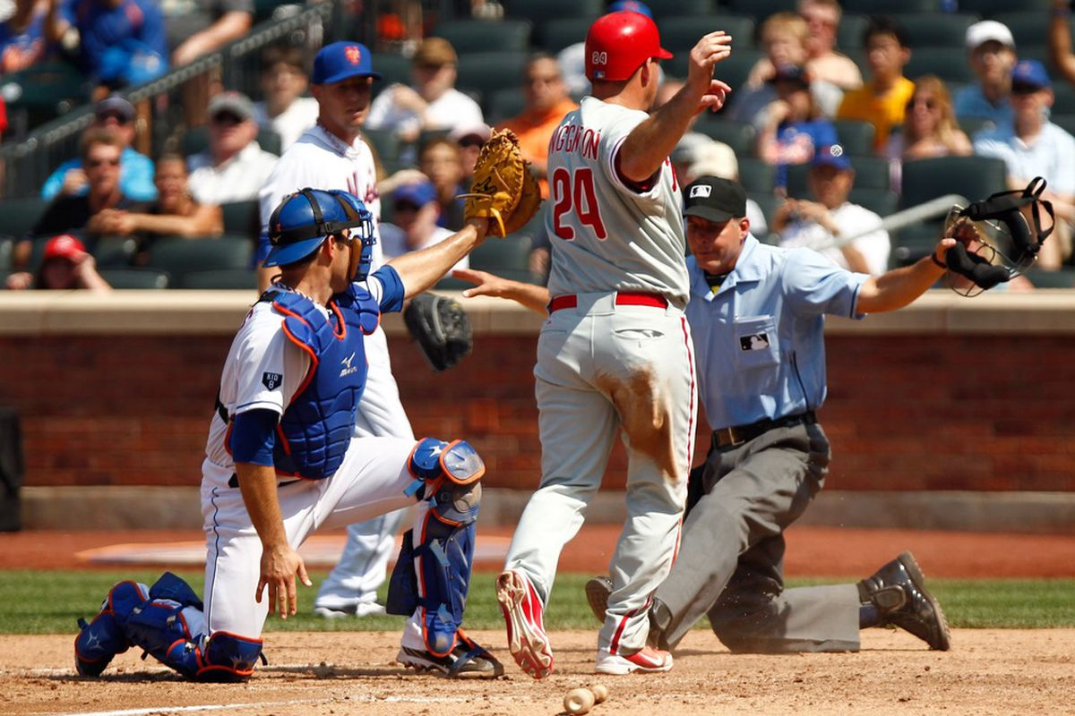 July 4, 2012; Flushing, NY, USA; Philadelphia Phillies first baseman Ty Wigginton (24) reacts after sliding past New York Mets catcher Mike Nickeas (4) during the eighth inning at Citi Field. Mandatory Credit: Debby Wong-US PRESSWIRE