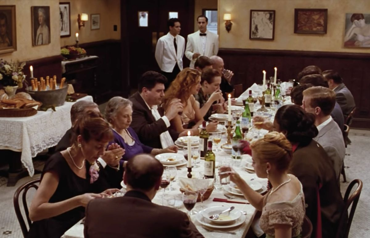 A large table full of people inside an Italian restaurant.