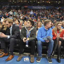 Fans wait for an announcement on the status of an an NBA basketball game between Oklahoma City Thunder and Utah Jazz in Oklahoma City, Wednesday, March 11, 2020.
