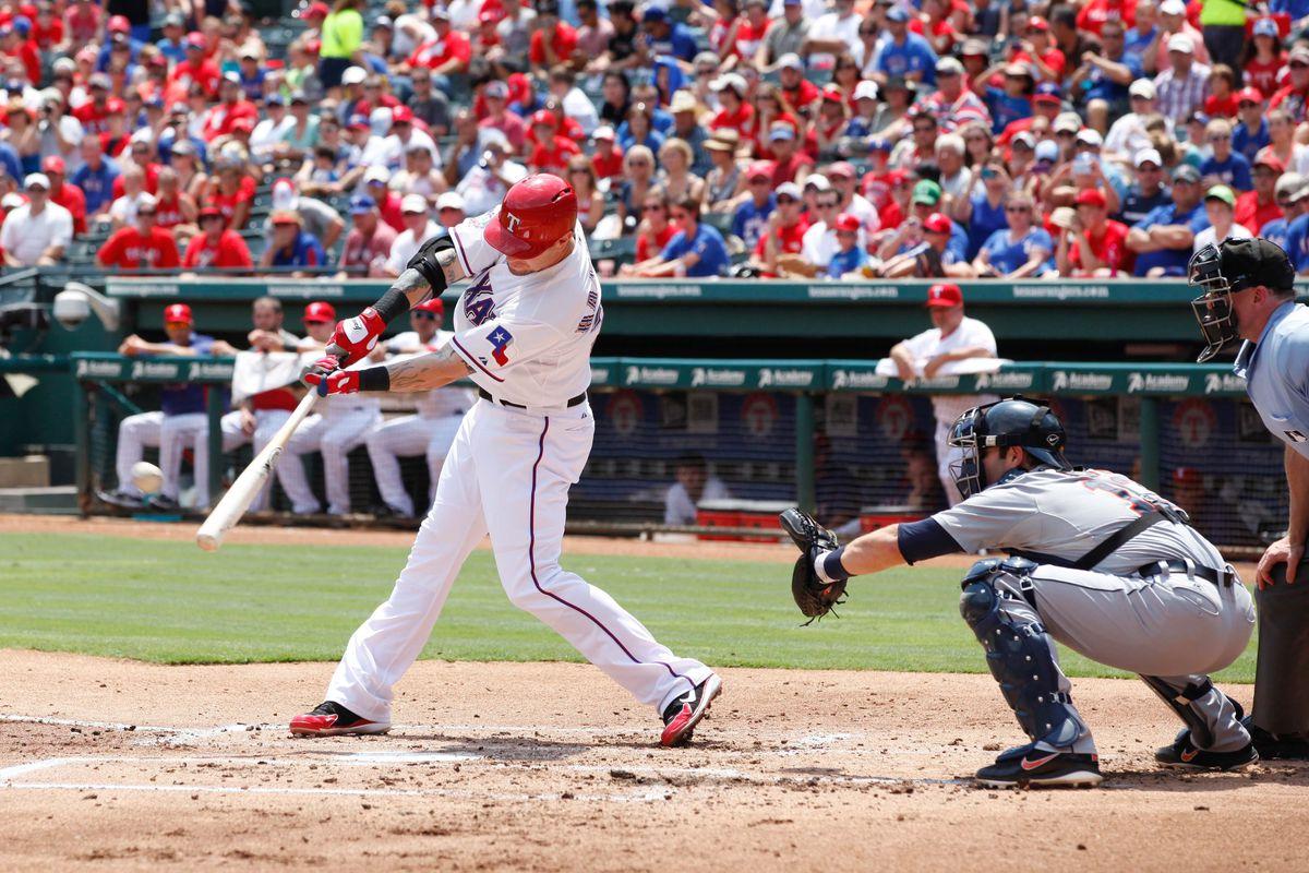Aug 12, 2012; Arlington, TX, USA; Texas Rangers center fielder John Hamilton (32) hits a two run home run during the first inning of the game against the Detroit Tigers at Rangers Ballpark. Mandatory Credit: Tim Heitman-US PRESSWIRE