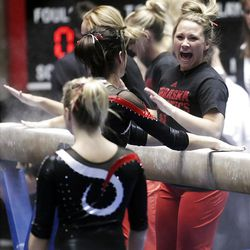 Nebraska gymnasts prepare the beam with chalk prior to performing at the NCAA Salt Lake Regional Gymnastics Saturday, April 7, 2012 in Salt Lake City.