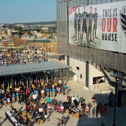Fans walk into Audi Field as the gates open