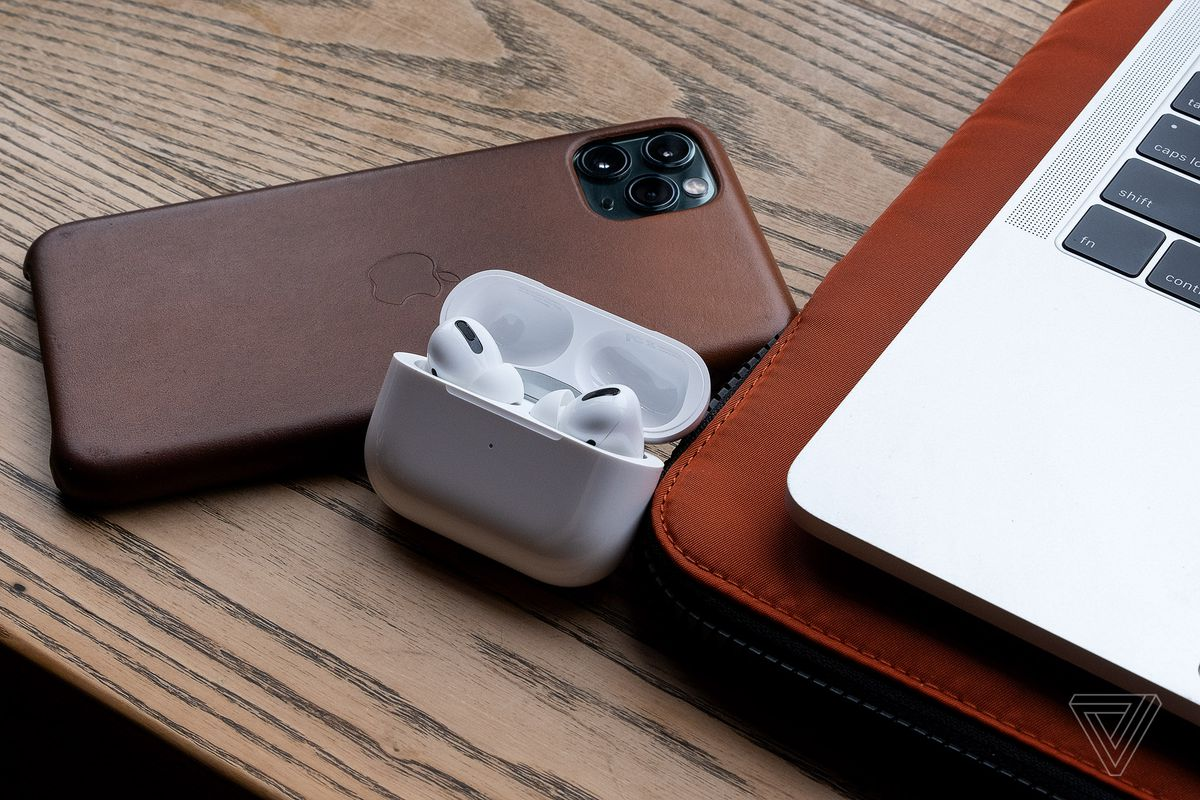 The AirPods Pro, the best wireless earbuds for people who use Apple products, pictured next to an iPhone 11 Pro Max and MacBook Pro.