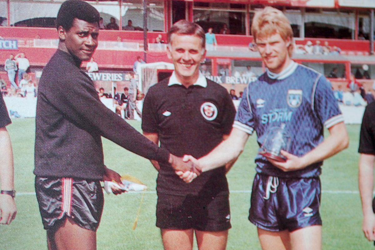 FC Seattle captain Dennis Gunnell is greeted by Sunderland's Gary Bennett prior 1988 friendly.