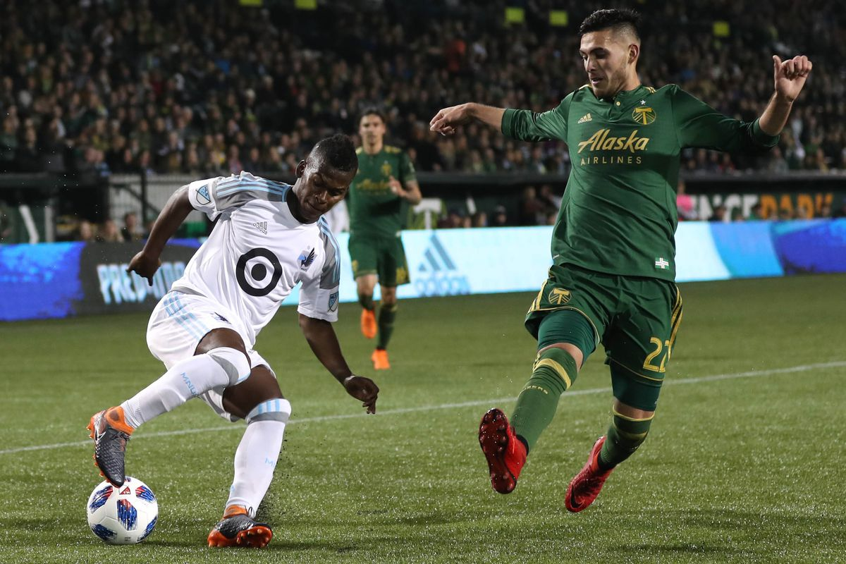 Minnesota United's Darwin Quintero wrong-footed Portland's Cristhian Paredes