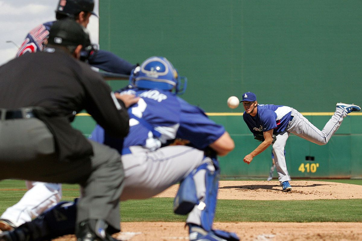 Mar 19, 2012; Goodyear, AZ, USA; Los Angeles Dodgers starting pitcher Clayton Kershaw (22) pitches during the first inning against the Cleveland Indians at Goodyear Ballpark.  Mandatory Credit: Jake Roth-US PRESSWIRE