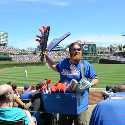 2:28 p.m. Vendor Mike working the stands. He works the souvenir stand outside of Gate D before, and after, the game -