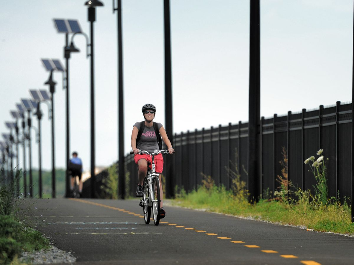 People riding bicycles along a bike path in Washington D.C.
