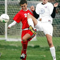 Taryn Smith, left, of Bountiful High and Kassidy Christensen of Woods Cross battle for control of the ball.