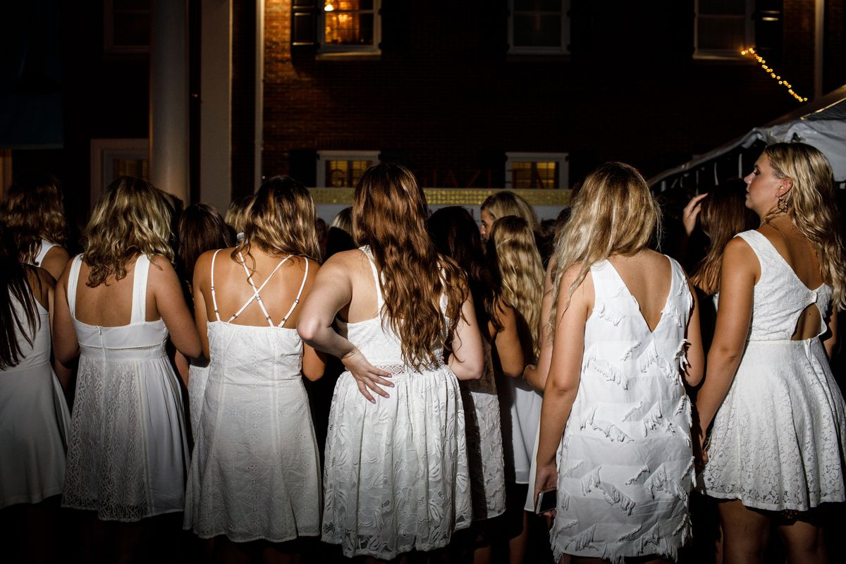 025c643f930 White dresses are worn by freshmen women on Bid Day.