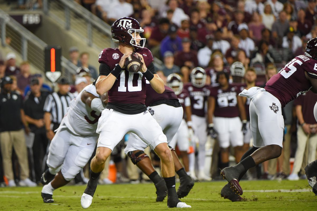 Texas A&M Aggies quarterback Zach Calzada looks to throw downfield during a game between the Alabama Crimson Tide and the Texas A&M Aggies at Kyle Field on October 9, 2021 in College Station, Texas.
