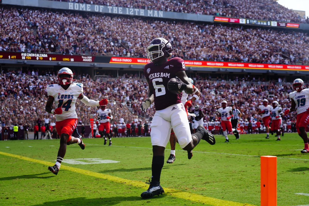 Running back Devon Achane of the Texas A&M Aggies scores a touchdown in the first quarter against the New Mexico Lobos at Kyle Field on September 18, 2021 in College Station, Texas.
