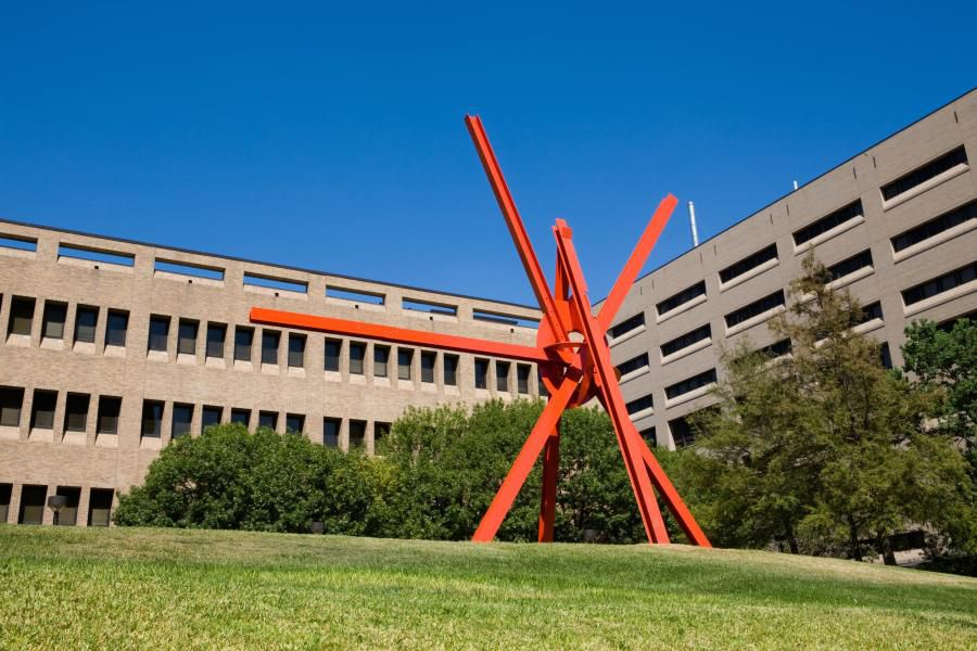 Photo of large orange metal outdoor abstract sculpture