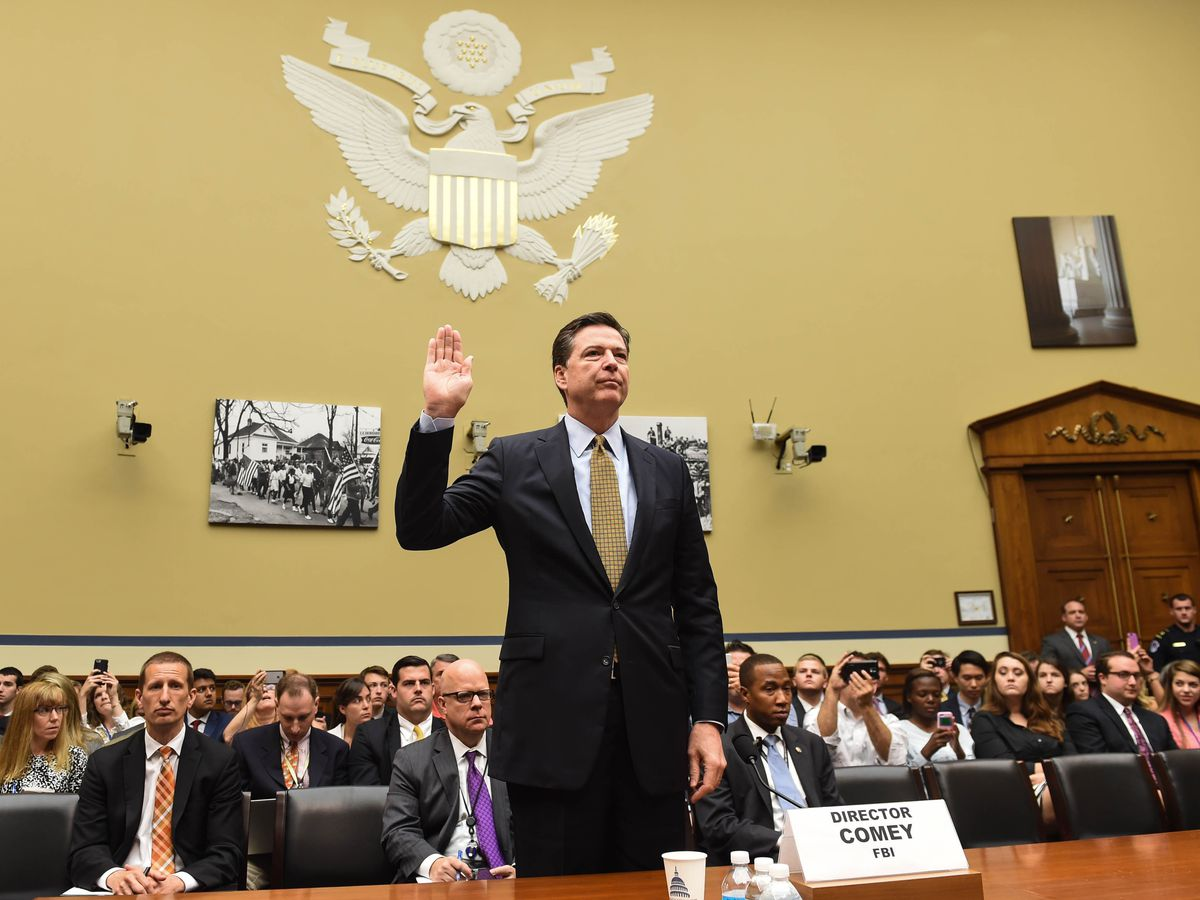 James Comey preparing to testify about his decision not to prosecute Hillary Clinton over her use of a private email server, in July.