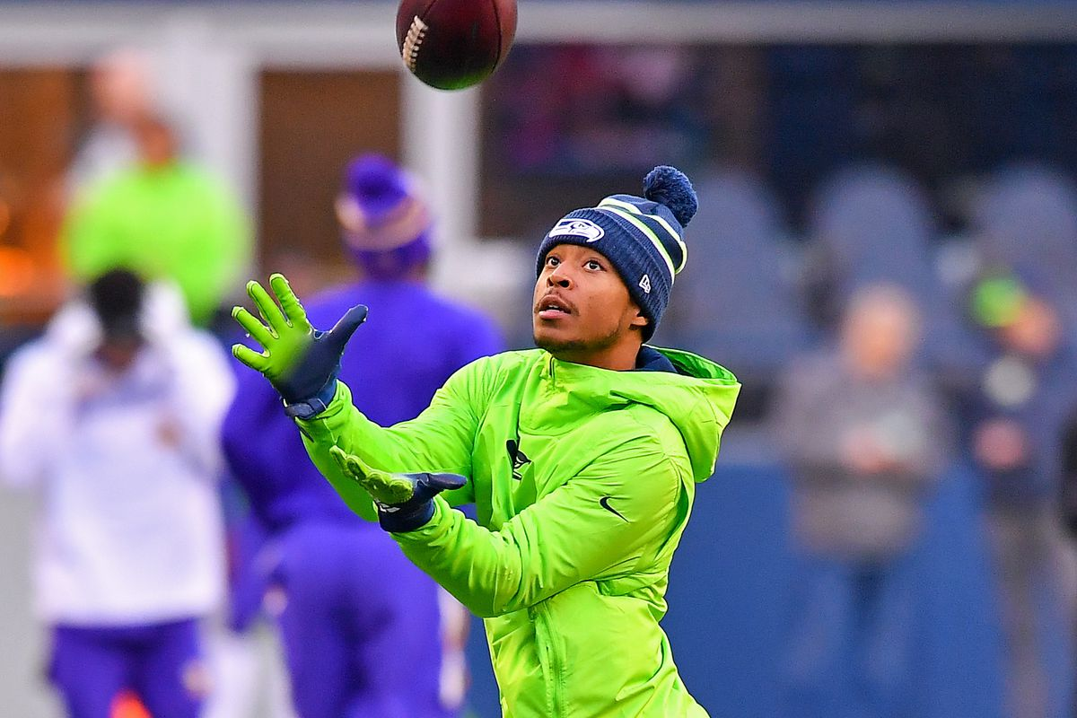 Tyler Lockett of the Seattle Seahawks warms up before the game against the Minnesota Vikings at CenturyLink Field on December 02, 2019 in Seattle, Washington.