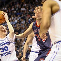 Brigham Young Cougars guard TJ Haws (30) tries a turn around shot when faced with the defense of St. Mary's Gaels center Jock Landale (34) as the BYU Cougars take on the Saint Mary's Gaels in the Marriott Center in Provo on Saturday, Dec. 30, 2017.