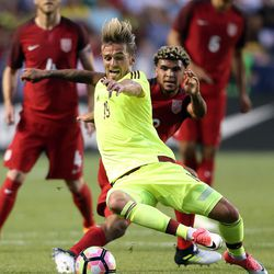 Venezuela's Christian Santos (19) kicks the ball in front of United States defender DeAndre Yedlin (2) during a soccer game at Rio Tinto Stadium in Sandy on Saturday, June 3, 2017.