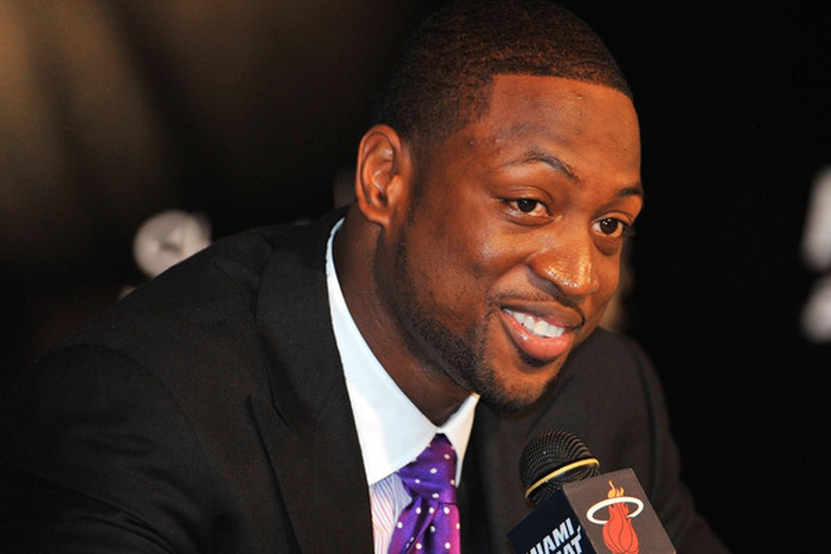 MIAMI - JULY 09:  Dwyane Wade #3 of the Miami Heat talks during a press conference after a welcome party at American Airlines Arena on July 9 2010 in Miami Florida.  (Photo by Doug Benc/Getty Images)