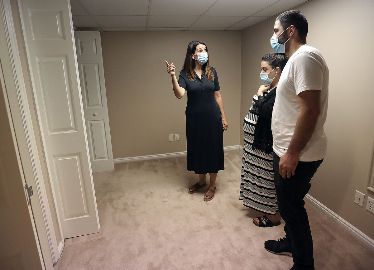 Realtor Dana Conway shows Sara Ismael and Yousif Yousif a house for sale in Sandy on Monday, July 20, 2020.