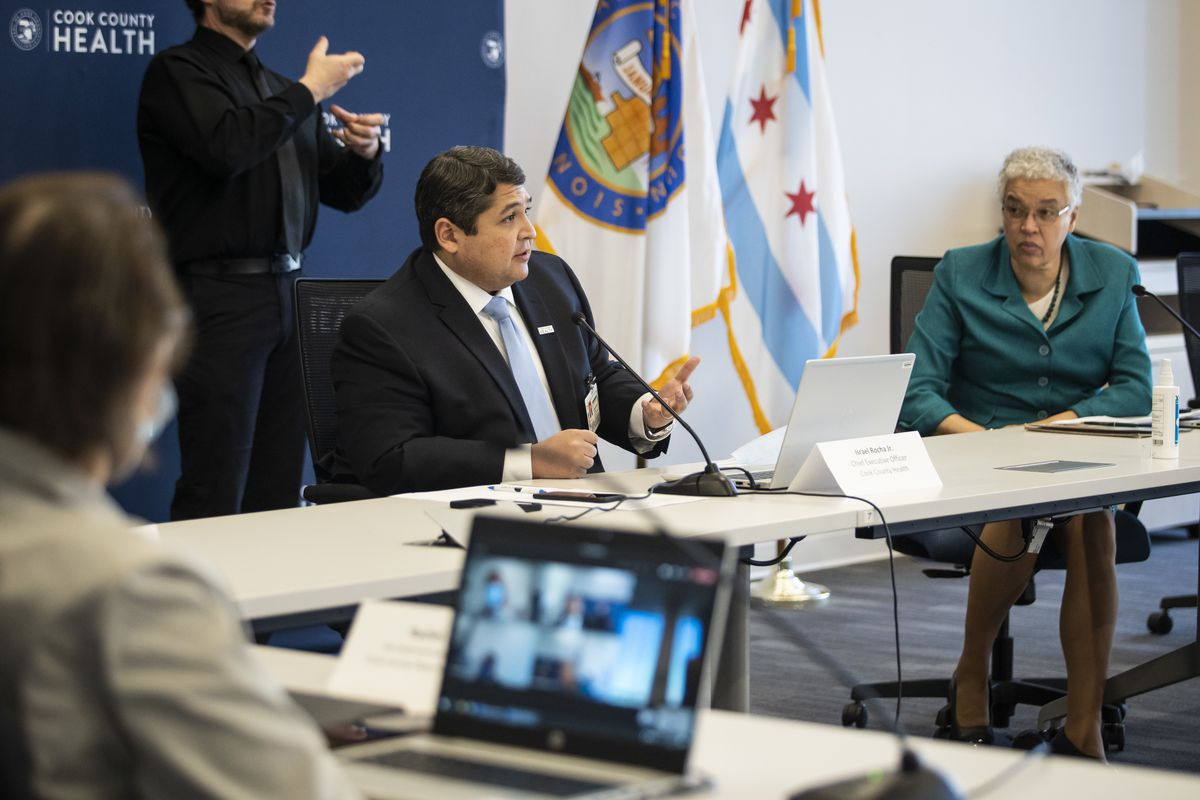 Israel Rocha Jr., CEO of Cook County Health, joins Cook County Board President Toni Preckwinkle at a meeting last December.