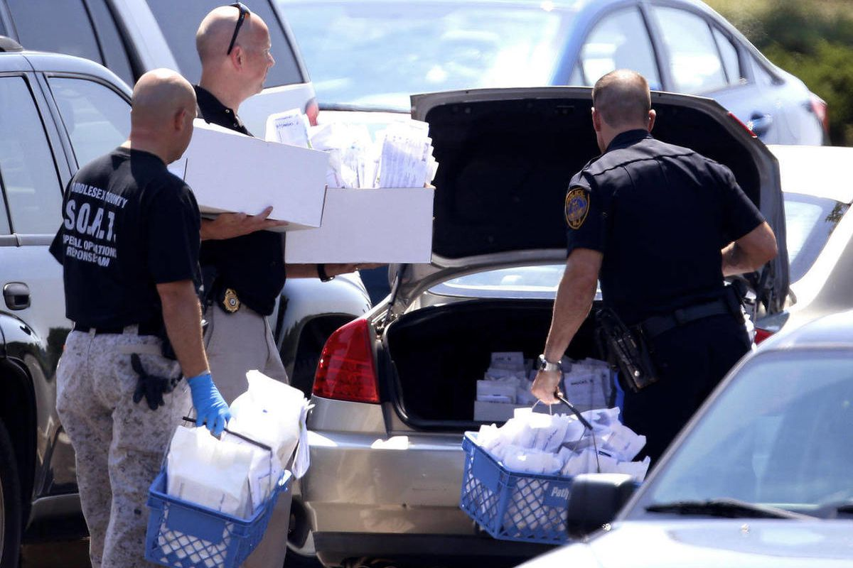Officials remove evidence from a Pathmark grocery store where three people died in an early morning shooting in Old Bridge, N.J., Friday, Aug. 31, 2012.  Officials say a supermarket employee killed two people at the store early Friday and then fatally sho