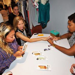 """The <a href=""""http://www.goscratchit.com/""""target=""""_blank"""">Scratch</a> nail wrap station was poppin' all night."""