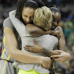 Baylor center Brittney Griner (42) and Baylor guard Jordan Madden (3) embrace Baylor head coach Kim Mulkey after the second half in the NCAA Women's Final Four college basketball championship game against the Notre Dame, in Denver, Tuesday, April 3, 2012.  Baylor won the championship 80-61. (AP Photo/Julie Jacobson)