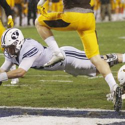 Brigham Young Cougars quarterback Tanner Mangum (12) scores on a dive into the endzone against the Wyoming Cowboys during the Poinsettia Bowl in San Diego on Wednesday, Dec. 21, 2016.