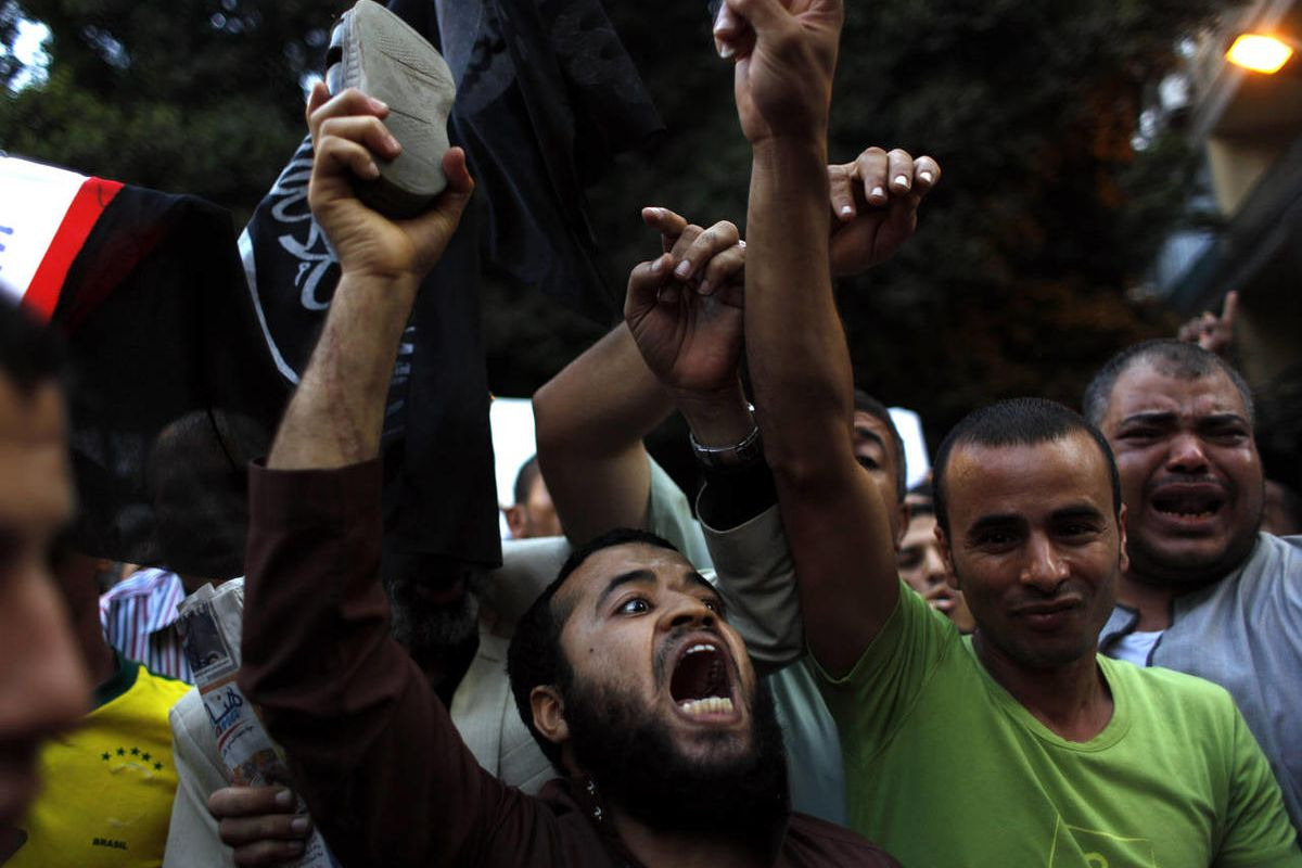 Egyptian protesters chant anti-U.S. slogans during a demonstration in front of the U.S. embassy in Cairo, Egypt, Wednesday, Sept. 12, 2012.