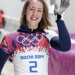 Elizabeth Yarnold of Great Britain waves to supporters after her third run during the women's skeleton competition at the 2014 Winter Olympics, Friday, Feb. 14, 2014, in Krasnaya Polyana, Russia.
