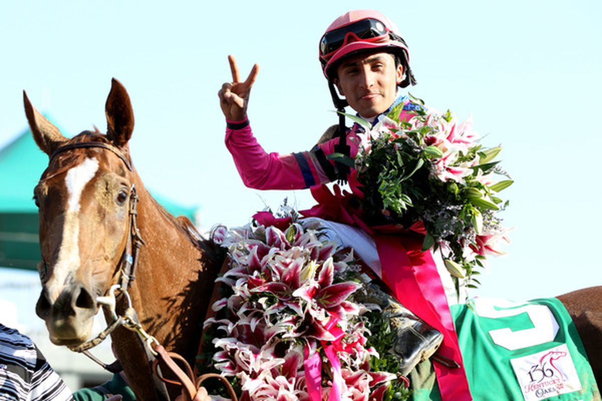 LOUISVILLE, KY - APRIL 30:  Rafael Bejarano atop Blind Luck celebrates after winning the 136th running of the Kentucky Oaks at Churchill Downs on April 30, 2010 in Louisville, Kentucky.  (Photo by Jamie Squire/Getty Images)