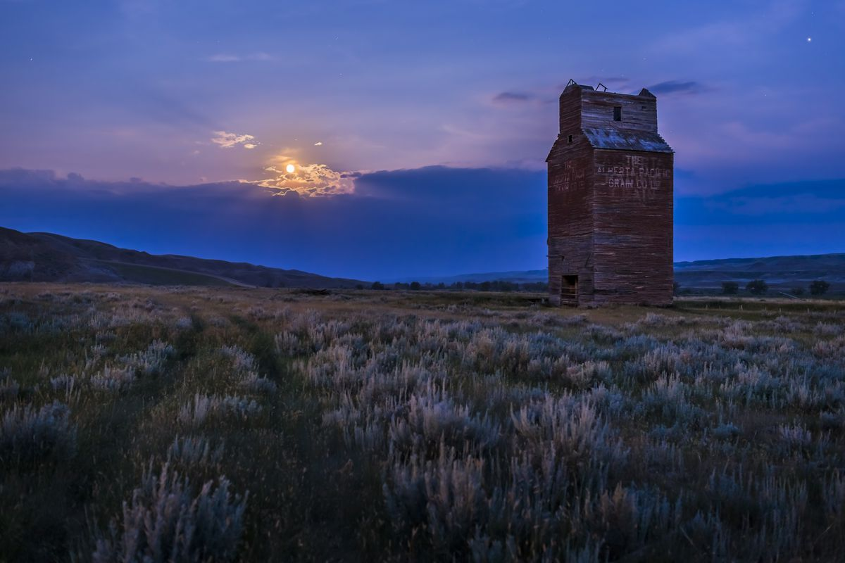The Full Moon rising behind the abandoned grain elevator at Dorothy