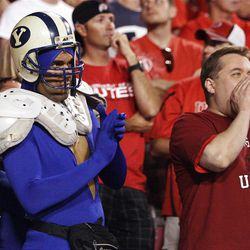 BYU and Utah fans cheer side by side in Salt Lake City  Sunday, Sept. 16, 2012.
