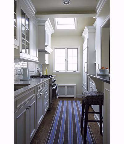 Pass through windows to create a more open galley kitchen.