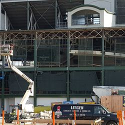 10:56 a.m. View of tarps and framework on west side of ballpark -