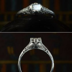 1920s Art Deco emerald cut diamond filigree ring, platinum. It's unusual to see filigree rings with anything but a round cut diamond. The geometry of emerald cut here is a really nice contrast to the lacy filigree. $1750.