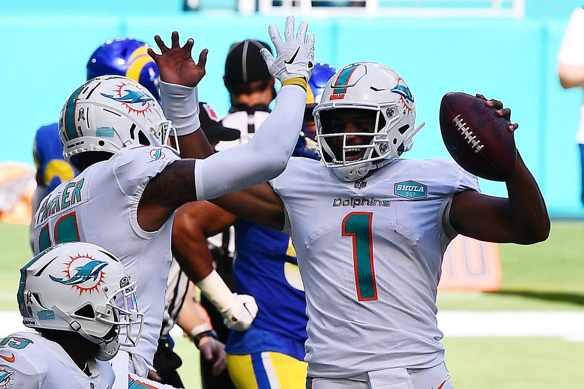 Tua Tagovailoa #1 of the Miami Dolphins celebrates his first NFL touchdown on a three-yard pass to DeVante Parker #11 against the Los Angeles Rams during their game at Hard Rock Stadium on November 01, 2020 in Miami Gardens, Florida.