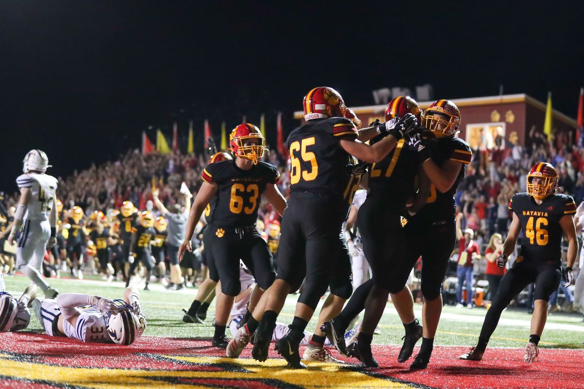 Batavia players celebrate Jalen Buckley's (27) winning touchdown during overtime in the game against Wheaton North.