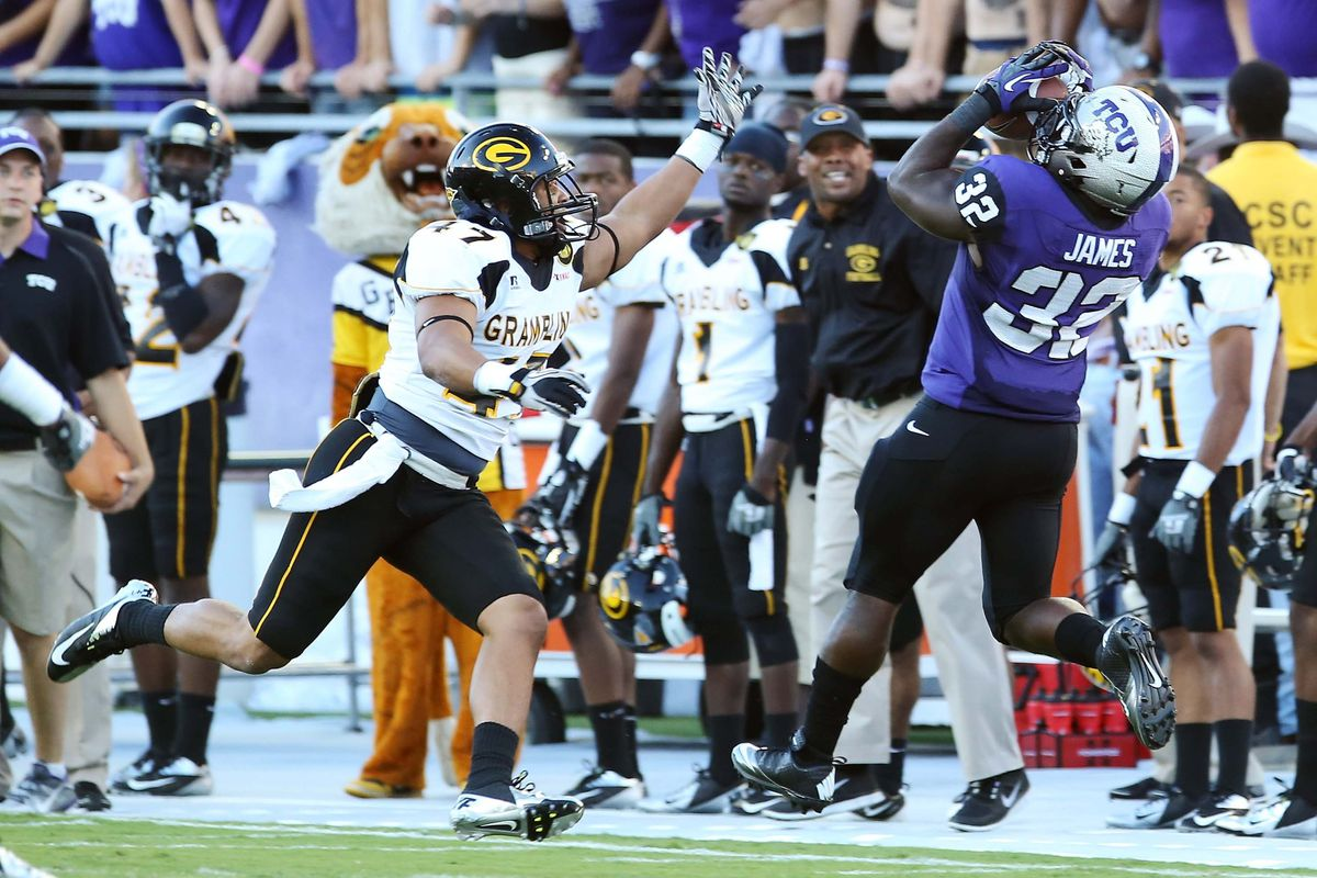 Sep 08, 2012; Fort Worth, TX, USA; TCU Horned Frogs running back Waymon James (32) makes a catch over Grambling State Tigers defensive back Tyler Smith (47) during the first half at Amon G. Carter Stadium.  Mandatory Credit: Kevin Jairaj-US PRESSWIRE